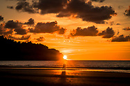 A couple watches the sunset in Kota Kinnabalu, Malaysia.