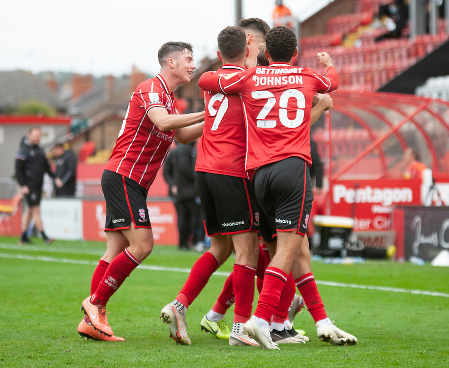 Lincoln City's Lewis Montsma celebrates scoring his side's second goal with team-mates<br /> <br /> Photographer Andrew Vaughan/CameraSport<br /> <br /> The EFL Sky Bet League One - Lincoln City v Charlton Athletic - Sunday 27th September, 2020 - LNER Stadium - Lincoln<br /> <br /> World Copyright © 2020 CameraSport. All rights reserved. 43 Linden Ave. Countesthorpe. Leicester. England. LE8 5PG - Tel: +44 (0) 116 277 4147 - admin@camerasport.com - www.camerasport.com