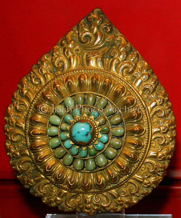 Reliquary with lotus ornament amid flames, gilt copper with inset turquoises, Tibet, 1700-1900.