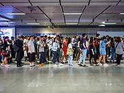 26 OCTOBER 2018 - BANGKOK, THAILAND:  Commuters wait to board subway trains (called the MRT in Bangkok) in the Sukhumvit MRT station.     PHOTO BY JACK KURTZ