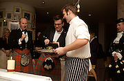 Ewan MacGregor and Haggis, Burns night charity supper, St. Martin's Lane Hotel. 25 January 2004. © Copyright Photograph by Dafydd Jones 66 Stockwell Park Rd. London SW9 0DA Tel 020 7733 0108 www.dafjones.com
