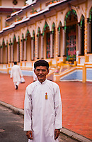 Male worshipper standing outside the Holy See in Tay Ninh.
