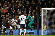Harry Kane of Tottenham Hotspur (2L) takes a shot at goal but sees it saved by Adrian, the West Ham goalkeeper. . Premier league match, Tottenham Hotspur v West Ham United at Wembley Stadium in London on Thursday  4th January 2018.<br /> pic by Steffan Bowen, Andrew Orchard sports photography.