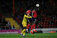 York City defender Kennedy Digie (4) heads the ball clear during the Vanarama National League match between York City and Chester FC at Bootham Crescent, York, England on 13 November 2018.