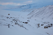 A UNIS student on a class field trip travels by snowmobile to the foot of Rabotbreen, Svalbard.