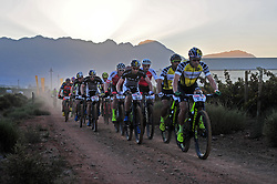 ROBERTSON, SOUTH AFRICA - MARCH 20: The Elite Men's group head out at the start of stage two's 110km from Robertson on March 20, 2018 in Cape Town, South Africa. Mountain bikers from across South Africa and internationally gather to compete in the 2018 ABSA Cape Epic, racing 8 days and 658km across the Western Cape with an accumulated 13 530m of climbing ascent, often referred to as the 'untamed race' the Cape Epic is said to be the toughest mountain bike event in the world. (Photo by Dino Lloyd)