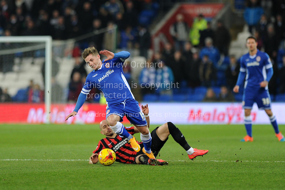 Conor McAleny of Cardiff city breaks away from the Tackle from Brighton's Bruno Saltor.  Skybet football league championship match, Cardiff city v Brighton & Hove Albion at the Cardiff city Stadium in Cardiff, South Wales on Tuesday 10th Feb 2015.<br /> pic by Andrew Orchard, Andrew Orchard sports photography.
