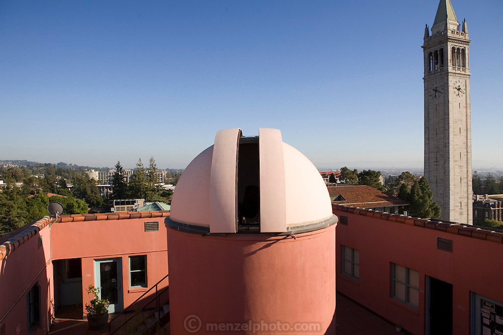 The roof of Cambell Hall at UC Berkeley (California) with a 14 inch telescope in the foreground.  Exoplanets & Planet Hunters
