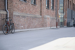 Bicycle leaning against a wall made of brick, Munich, Bavaria, Germany