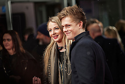 © Licensed to London News Pictures. 13/02/2014. London, UK. Ray Quinn and Sadie Pickering as they attend during A New York Winter's Tale premiere outside the Odeon Kensington. Photo credit : Andrea Baldo/LNP