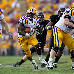 Sep 18, 2010; Baton Rouge, LA, USA;  LSU Tigers running back Stevan Ridley (34) runs against the Mississippi State Bulldogs during the first half at Tiger Stadium.  Mandatory Credit: Derick E. Hingle