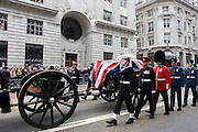 London 17/4/13 - Draped in the union flag and mounted on a gun carriage, the coffin of ex-British Prime Minister Baroness Margaret Thatcher's coffin travels along Fleet Street towards St Paul's Cathedral in London, England. Afforded a ceremonial funeral with military honours, not seen since the death of Winston Churchill in 1965, family and 2,000 VIP guests (incl Queen Elizabeth) await her cortege.