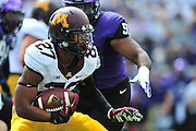 FORT WORTH, TX - SEPTEMBER 13:  David Cobb #27 of the Minnesota Golden Gophers carries the ball against the TCU Horned Frogs on September 13, 2014 at Amon G. Carter Stadium in Fort Worth, Texas.  (Photo by Cooper Neill/Getty Images) *** Local Caption *** David Cobb