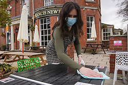 © Licensed to London News Pictures. 8/04/2021. Sheffield, UK A member of staff cleans the tables at The Francis Newton pub in Sheffield as  beer gardens prepare to re-open after the lockdown restrictions were eased further.Photo credit:  Ioannis Alexopoulos/LNP