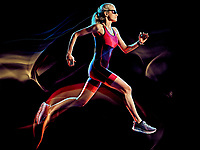 one caucasian woman triathlon triathlete runner running joogger jogging studio shot  isolated on black background with light painting effect