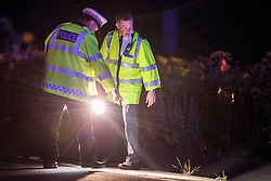© Licensed to London News Pictures . 21/07/2014 . Ranby , UK . Police examine a footpath near scene where three people have died in a crash involving a number of vehicles on the A1 road at Ranby, near Worksop, Nottinghamshire this morning (21/07/2014).  Photo credit : Joel Goodman/LNP