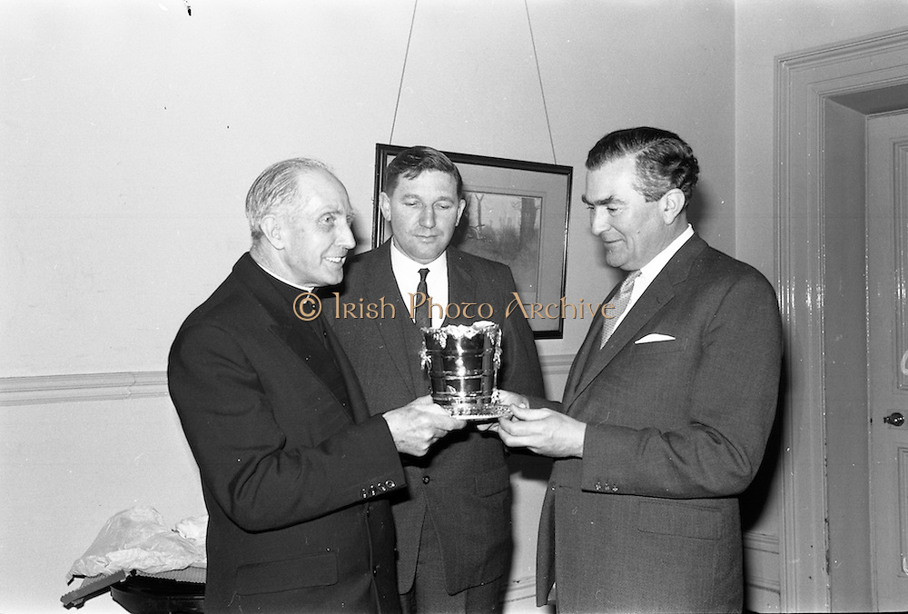 08/04/1963<br /> 04/08/1963<br /> 08 April 1963<br /> W.D. & H.O. Wills Reception for Mr John Ware at the Shelbourne Hotel, Dublin. Reception held on the departure of Mr. Ware and for his successor Mr. Mott. Picture shows (l-r):rev. Daniel Joseph Lucey P.P. Glasthule and Sallynoggin, Patron, Glenageary Horse Show; P.T. Finnegan, Press Officer of the Horse Show, Making a presentation to Mr. Ware. Mr Ware was about to go to Bristol to take up the job of Assistant to W.S.J. Carter who was succeeding to the post of Managing Director of the Firm.