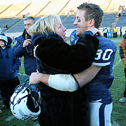 Yale running back Tyler Varga, is embraced by his grandmother Marita Sundberg after he scored three touchdowns during the Yale Vs Princeton, Ivy League College Football match at Yale Bowl, New Haven, Connecticut, USA. 15th November 2014. Photo Tim Clayton