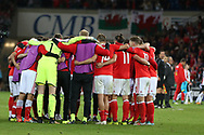 The Wales players huddle together at the end of the match that they win 1-0. Wales v Austria , FIFA World Cup qualifier , European group D match at the Cardiff city Stadium in Cardiff , South Wales on Saturday 2nd September 2017. pic by Andrew Orchard, Andrew Orchard sports photography