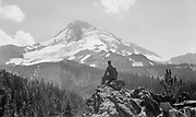 1307C-48. silhouette of a hiker on the rocks above the Lost Lake Butte Trail looking toward the summit Mt. Hood