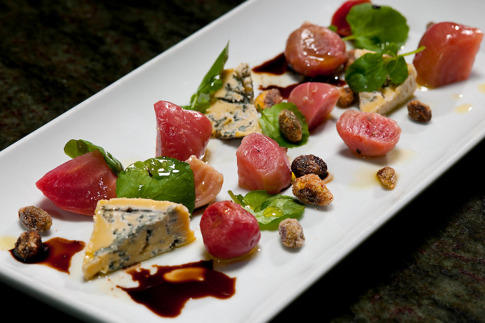 Food specialties created by the talented and creative Chef Jason Dodge at Peche Restaurant and Bar.   Roasted Springdale Farms Beets with Watercress Leaves, Spiced Pistachios, Queso de Valdeon, and 3 Vinegars and Stilton bleu cheese cheescake.