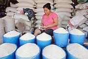 "Mar. 11, 2009 -- VIENTIANE, LAOS:  A rice vendor counts her ""kip"" (Laotian money) in a market in Vientiane, Laos. Photo by Jack Kurtz / ZUMA Press"