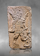 Aslantepe Hittite relief sculpted orthostat stone panel. Limestone, Aslantepe Malatya, 1200-700 B.C. Anatolian Civilizations Museum, Ankara, Turkey.<br /> <br /> Winged protective god holds a branch with fruits. in his left hand, and a fruit in his right hand.<br /> <br /> Against a grey art background. <br /> <br /> If you prefer to buy from our ALAMY STOCK LIBRARY page at https://www.alamy.com/portfolio/paul-williams-funkystock/hittite-art-antiquities.html . Type - Aslantepe - in LOWER SEARCH WITHIN GALLERY box. Refine search by adding background colour, place, museum etc.<br /> <br /> Visit our HITTITE PHOTO COLLECTIONS for more photos to download or buy as wall art prints https://funkystock.photoshelter.com/gallery-collection/The-Hittites-Art-Artefacts-Antiquities-Historic-Sites-Pictures-Images-of/C0000NUBSMhSc3Oo