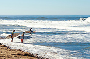 Surfers Going out at Lowers Trestles