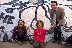 April 27, 2017 - Washington, District of Columbia, U.S - Youth plaintiffs LEVI DRAHEIM, center, and JACOB LEBEL, right, play under a colorful cloth on the sidewalk in front of the Supreme Court in Washington, D.C., before a a press conference. Draheim and and Lebel are among 21 plaintiffs represented by Our Children's Trust in a landmark federal lawsuit which accuses the federal government of violating their constitutional rights. (Credit Image: © Robin Loznak via ZUMA Wire)