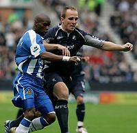 Photo: Dave Howarth.<br />Wigan Athletic v Bolton Wanderers. The Barclays Premiership. 02/10/2005.  Wigains Henri Camara battles with Henrik Pederson