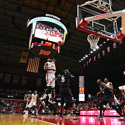 Wally Judge #33 of the Rutgers Scarlet Knights hooks a shot over Anthony Lee #3 of the Temple Owls during the first half of Rutgers men's basketball vs Temple Owls in American Athletic Conference play on Jan. 1, 2014 at Rutgers Louis Brown Athletic Center in Piscataway, New Jersey.