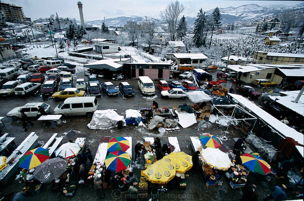 Signs of the four-year siege of Sarajevo are still obvious today. Although food stalls have returned to the Ciglane market, parts of the Olympic park behind it have become a burial ground for siege victims. Hungry Planet: What the World Eats (p. 49). This image is featured alongside the Dudo family images in Hungry Planet: What the World Eats.