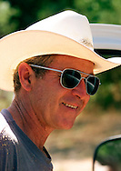U.S. President George W. Bush wearing a sweat-stained cowboy hat and sunglasses gets into his truck on his Crawford, Texas Prarie Chapel Ranch August 25, 2001.  Bush is winding up a nearly month-long working vacation at the ranch.  REUTERS/Rick Wilking