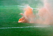 An orange flare thrown from the Blackpool fans during the EFL Sky Bet League 1 match between Fleetwood Town and Blackpool at the Highbury Stadium, Fleetwood, England on 25 November 2017. Photo by Paul Thompson.