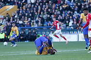 Krystian Pearce of Mansfield Town (5) takes a tumble during the The FA Cup match between Mansfield Town and Charlton Athletic at the One Call Stadium, Mansfield, England on 11 November 2018.