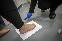 26 February 2020, Abu Dis, Palestine: Nurse Najwa Hawamdeh administers a foot exam of a patient from Abu Dis. Here, drawing up the size of her foot to test that her shoes are spacious enough, as Diabetes patients often develop sensitive feet. In an effort to make Diabetes services more accessible to people in the West Bank, the Augusta Victoria Hospital offers a Mobile Diabetes Clinic, which moves around to various locations in the West Bank, offering screening and routine testing for Diabietes and the symptoms it causes.