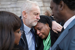 © Licensed to London News Pictures. 14/12/2017. London, UK. Labour Party Leader Jeremy Corbyn hugs Nyalissa Mendy after they attended  St Paul's Cathedral for the Grenfell Tower National Memorial Service mark the six month anniversary of the Grenfell Tower fire. Ms Mendy is a releative of Grenfell fire victim Mary Mendy. Diane Abbott, Shadow Health Secretary (L) and family friend Damel Carayol (R) look on. The service is attended by survivors and relatives of those who lost their lives in the fire, as well as members of the emergency services and members of the Royal family. 71 people were killed when a huge fire ripped though 24-storey Grenfell Tower block in west London in June 2017. Photo credit: Peter Macdiarmid/LNP
