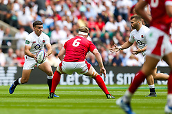 George Ford of England is challenged by Aaron Wainwright of Wales - Rogan/JMP - 11/08/2019 - RUGBY UNION - Twickenham Stadium - London, England - England v Wales - Quilter Series.