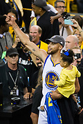 Golden State Warriors guard Stephen Curry (30) celebrates beating Cleveland Cavaliers during Game 5 of the NBA Finals to become NBA Champions with his daughter, Riley, at Oracle Arena in Oakland, Calif., on June 12, 2017. (Stan Olszewski/Special to S.F. Examiner)