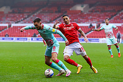 Matt Grimes of Swansea City is pursued by Nottingham Forest's Anthony Knockaert - Mandatory by-line: Nick Browning/JMP - 29/11/2020 - FOOTBALL - The City Ground - Nottingham, England - Nottingham Forest v Swansea City - Sky Bet Championship
