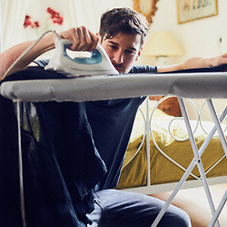 Parker Marx, an adult performer in the independent porn industry, ironing his shirt in an apartment in Paris, France. December 6, 2017.<br /> Parker Marx, acteur dans le milieu du film pornographique independant, passe le fer a repasser sur sa chemise dans un appartement a Paris, France. 6 december 2017.