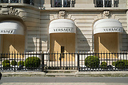 """March, 27th 2020 - Paris, Ile-de-France, France: Paris under confinement, Versace, Avenue Montaigne area of high fashion, beauty, accessories, haute couture, all shops closed, in 8th arrondissement, and all public spaces virtually empty to stop the spread of the Coronavirus, during the eleventh day of near total lockdown imposed in France. The President of France, Emmanuel Macron, said the citizens must stay at home for at least 15 days, that has been extended. He said """"We are at war, a public health war, certainly but we are at war, against an invisible and elusive enemy"""". All journeys outside the home unless justified for essential professional or health reasons are outlawed. Anyone flouting the new regulations is fined. Nigel Dickinson"""