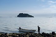 fisherman with boat fishing at Umikaze park, Yokosuka with Tokyo Bay and Sarushima Island