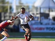 Fiji player Joshua Vikirinabili breaks a Russian tackle in the game Fiji vs Russia during the USA Sevens Rugby Series at Sam Boyd Stadium, Las Vegas, USA on 2 March 2018. Picture by Ian  Muir.