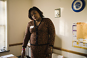 UNIONTOWN, AL – DECEMBER 11, 2019: Keshee Dozier-Smith, 34, stands in a doctor's office at Uniontown Health Center, where she received medical care as a child. As the new Chief Executive Officer of Rural Health Medical Program, Dozier-Smith now oversees the operation of the clinic.<br /> <br /> Since joining Rural Health Medical Program as Chief Executive Officer in March 2016, Dozier-Smith has effectively moderned the 35-year-old floundering business – opening three new clinics, streamlining processes and reaching out to local companies to offer healthcare services for employees. In the wake of rising hospital closures that leave Alabama's poorest citizens disproportionately cut off from access to medical care, Dozier-Smith represents a renewed effort to bridge the rural gap by offering a quality, affordable healthcare option.