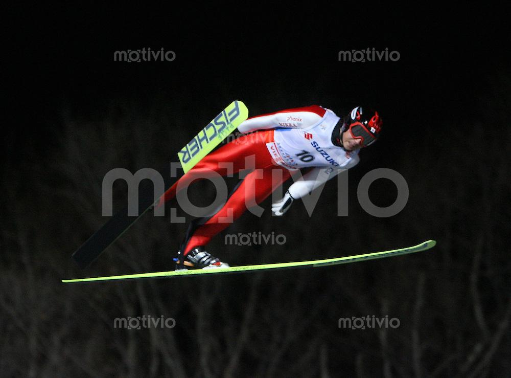 Sapporo , 240207 , Nordische Ski Weltmeisterschaft  Skispringen Grosschanze ,  Takanobu OKABE (JPN)