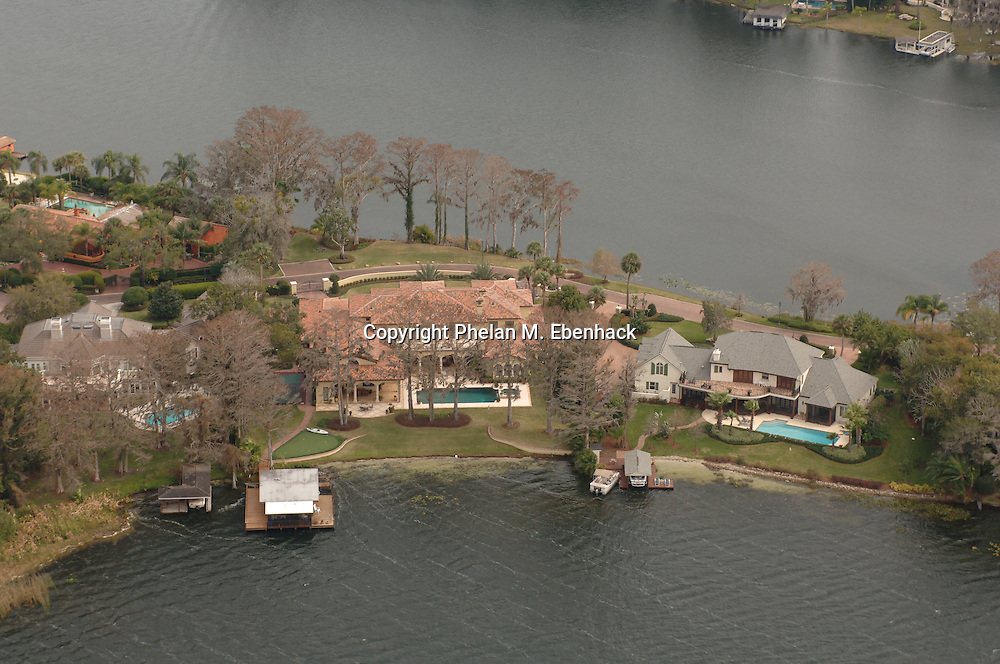 A aerial view of the waterfront home of Boston Celtics head basketball coach Doc Rivers, center, in Winter Park, Florida.  The home in the upper-left-hand corner of the photo is owned by comedian Scott Thompson, otherwise known as, Carrot Top.