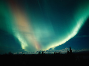 Green and red aurora during geomagnetic storm on the night of October 27-28, 2001, over the Tokosha Mountains and Mt. McKinley, Denali State Park, Alaska.
