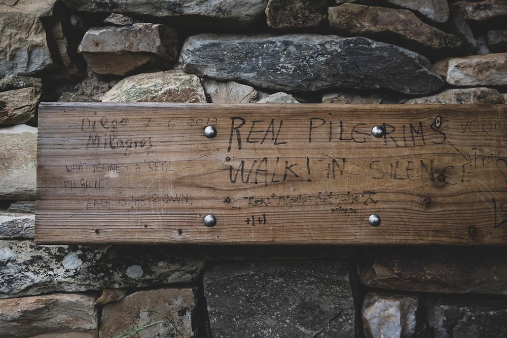 "Graffiti at a shelter outside Rabanal del Camino reads ""real pilgrims! walk in silence."" (July 1, 2018)"