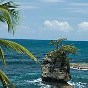Central America, Centro America, Latin America, Latin, tropical, Costa Rica, Puerto Viejo, Caribbean, Manzanillo Wildlife Refuge, Manzanillo, Lone rock pokes through the pounding surf in the Manzanillo Wildlife Refuge, Costa Rica.